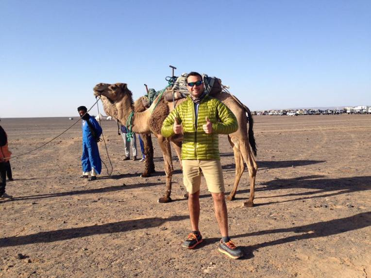 Man in desert with camel